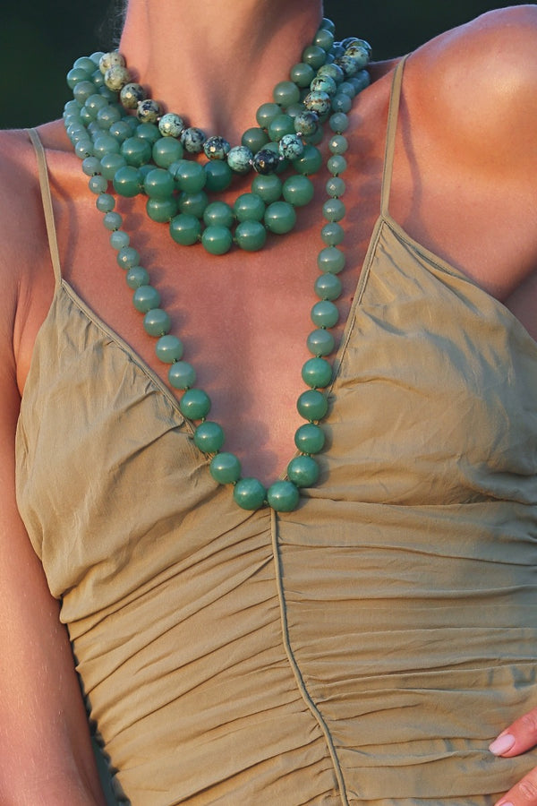 layer several chunky green gemstone necklaces