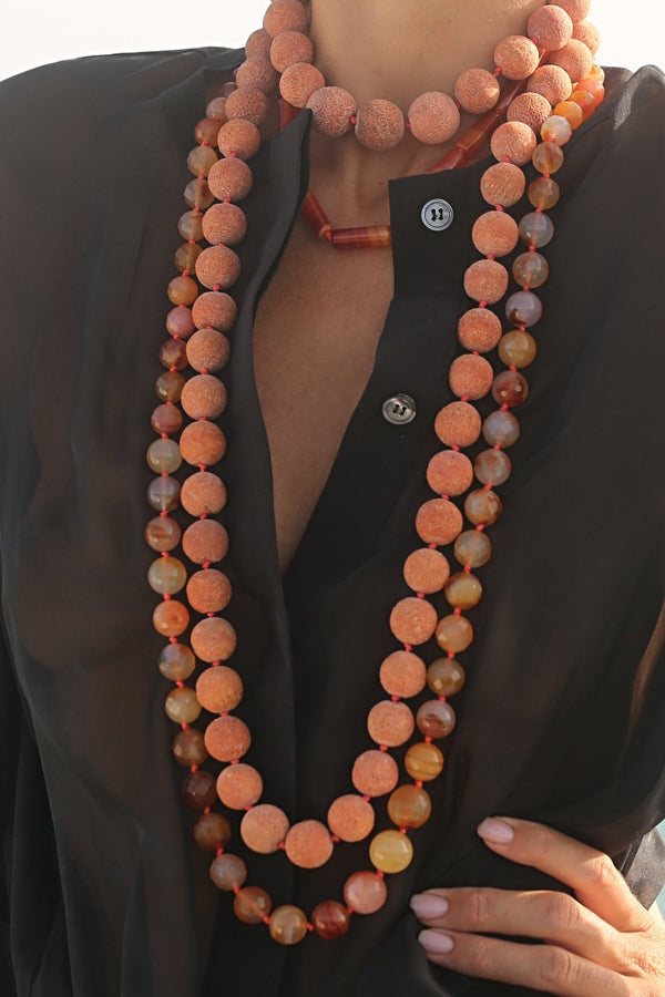 layer carnelian necklaces with chunky coral necklaces for a perfect outfit