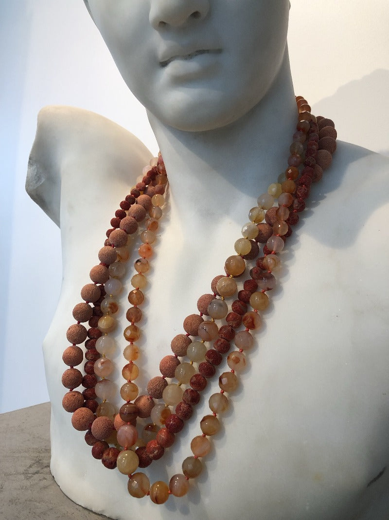 layer coral necklaces with more gemstone jewelry