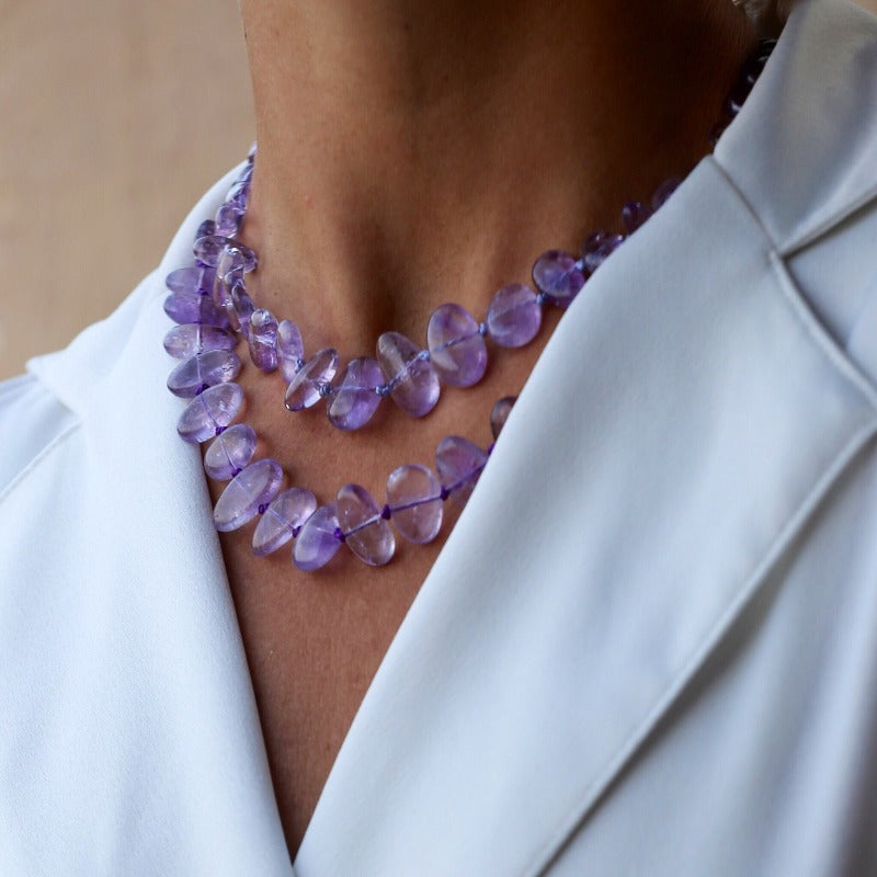 layer amethyst necklaces with a white shirt