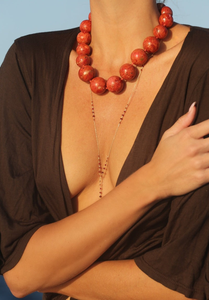 wear a dainty body chain with a coral necklace