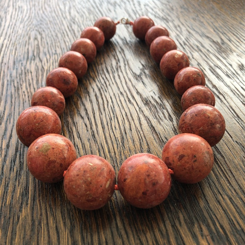 details from orange coral gemstone necklace