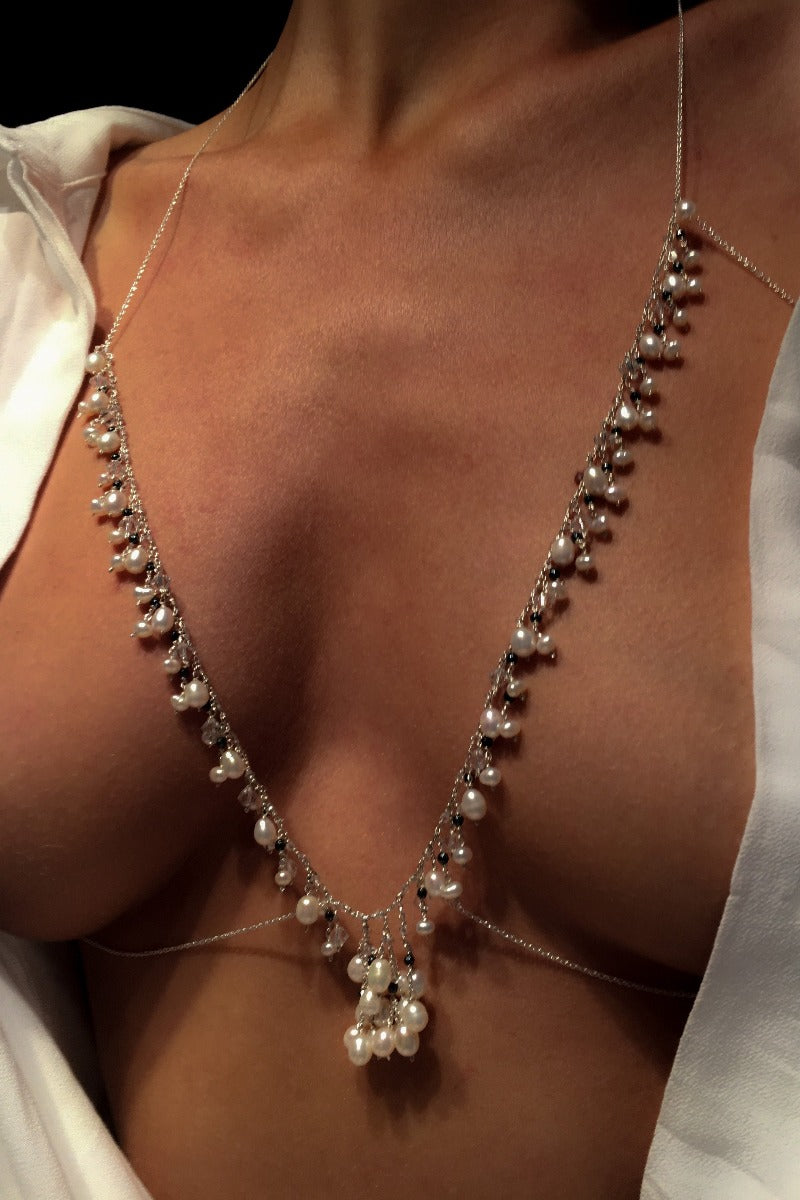 bralette with pearls perfect to layer under a white shirt