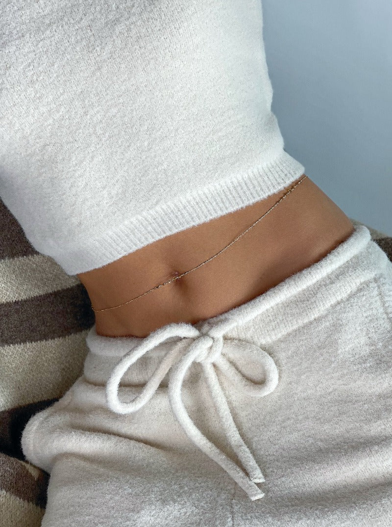 wear a gold belly chain with a cozy jogging pants