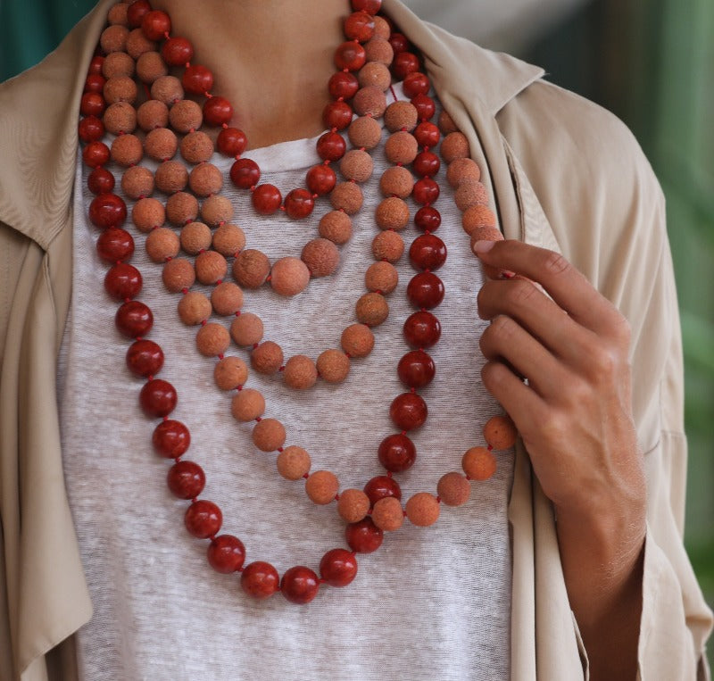 wear a coral necklace with a white basic shirt