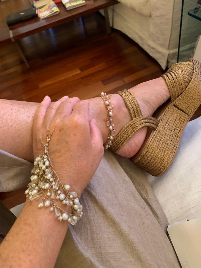 wear a matching pearl anklet with a pearl hand chain