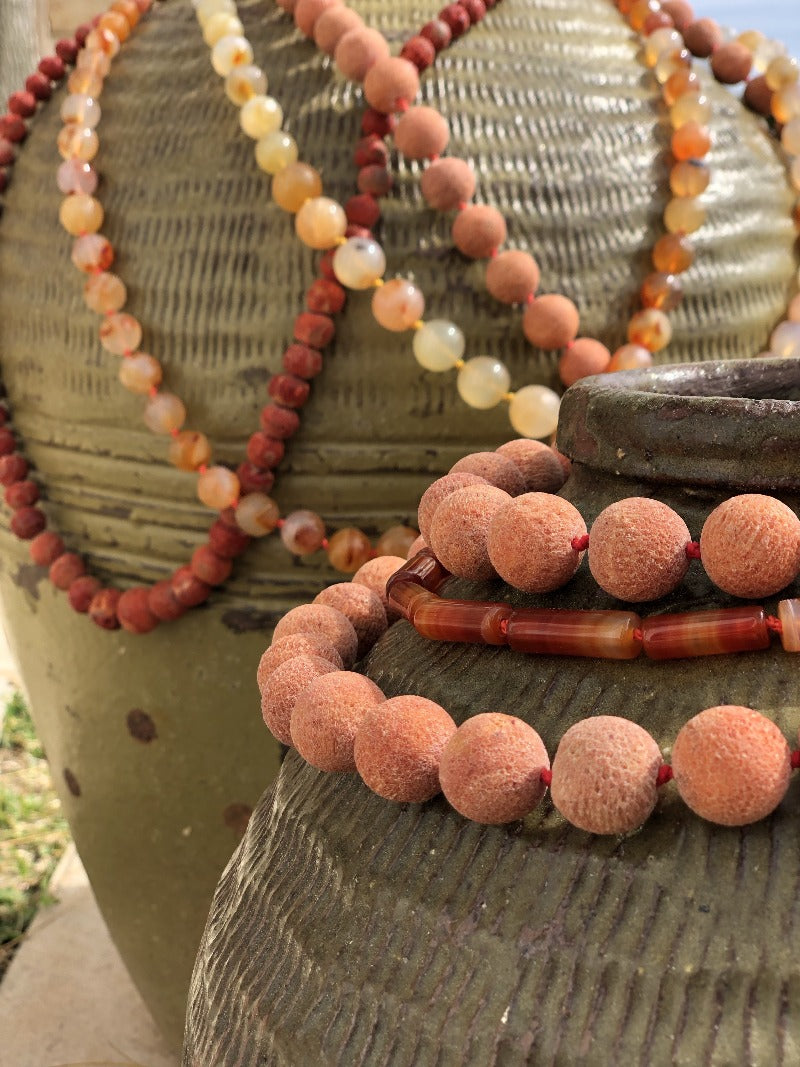 layer several carnelian gemstone necklaces