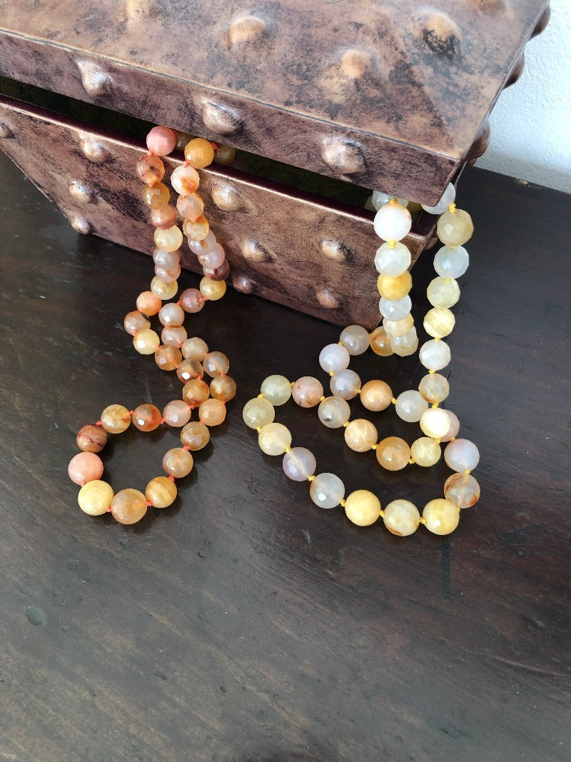 layer several carnelian necklaces