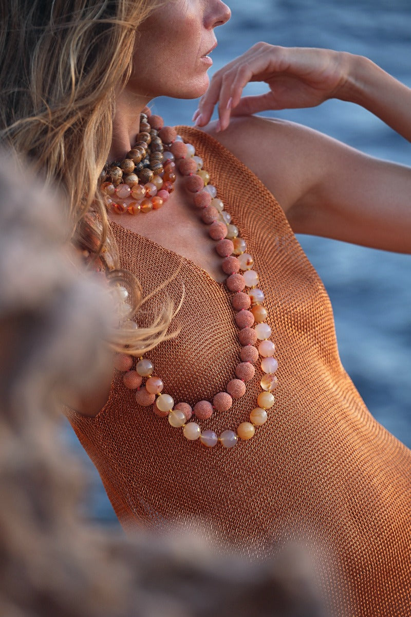 layer different colors and textures with coral and carnelian necklaces