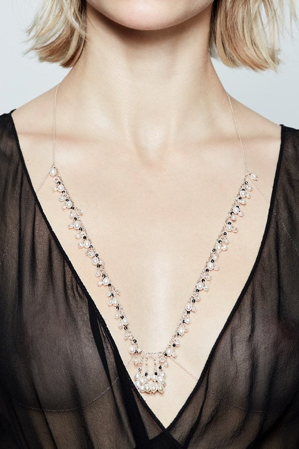 sensual and elegant bralette with black gemstones and pearls