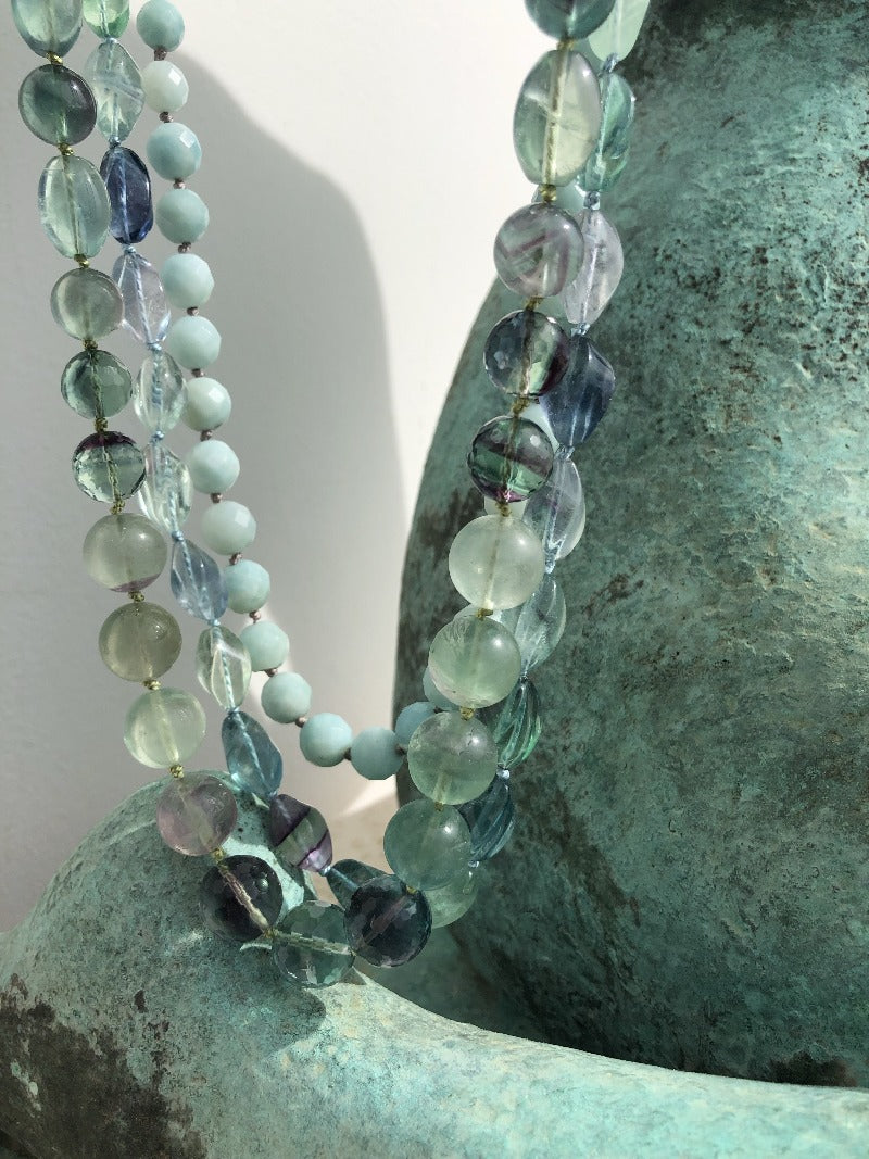 layer different textures of turquoise and blue gemstones