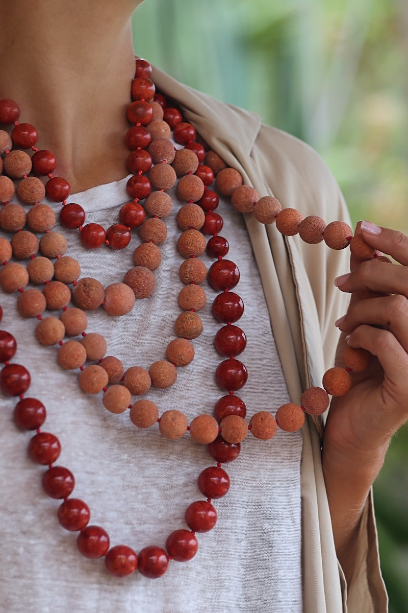 layer long red and orange coral necklaces