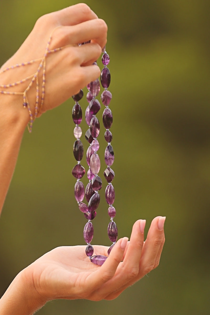 wear a long and elegant fluorite necklace