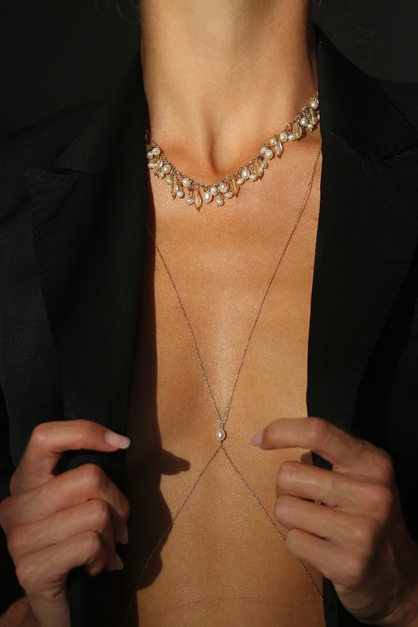 layer timeless pearl necklace with a gold body chain