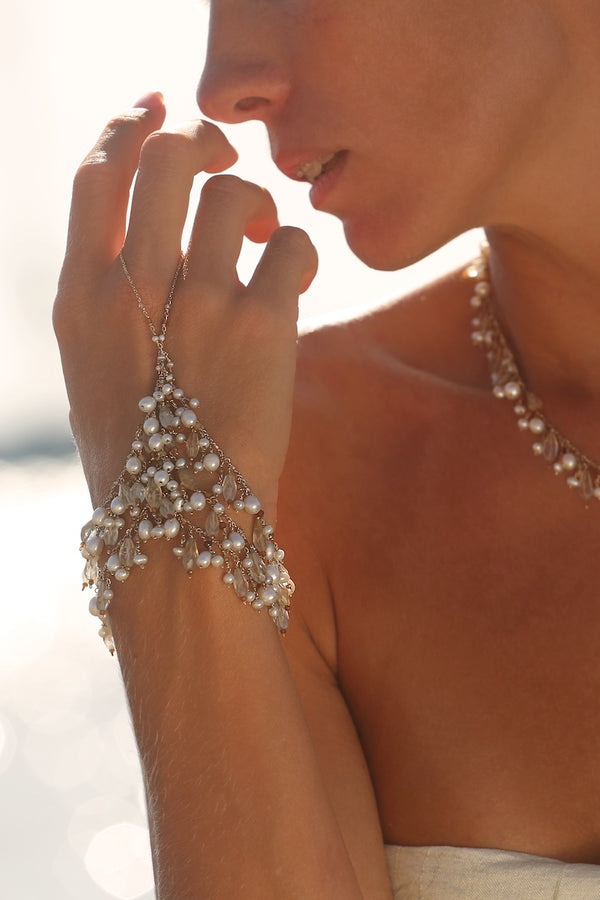 elegant and luxurious pearl and citrine hand chain jewelry