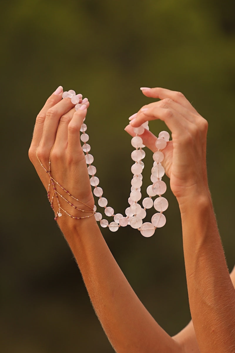 layer the hand chain with a rose quartz gemstone necklace