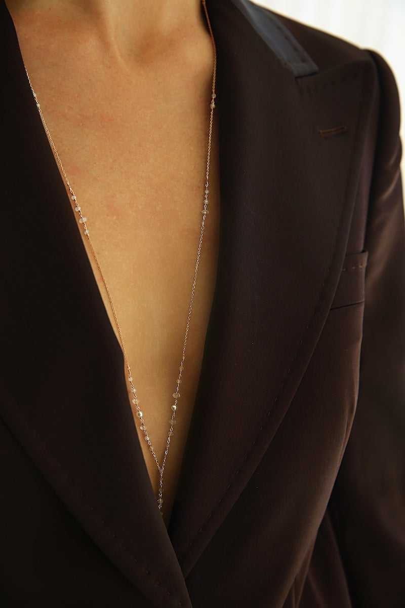 wear a body chain with a suit