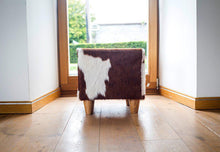 red and white cowhide footstool