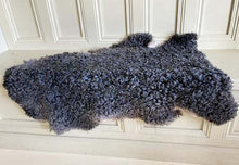 Curley grey sheepskin rug