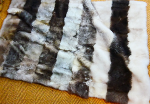 grey and black lambskin throw