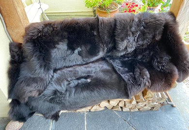 large black quad sheepskin rug
