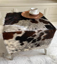 red and black cowhide footstool