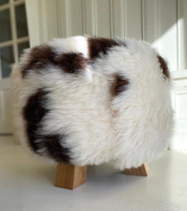 brown and white sheepskin stool