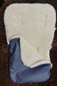 Sheepskin baby nest with baby shoes