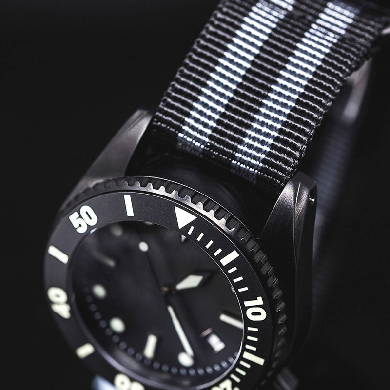 Enoksen - Deep Dive Black Edition - Deep Dive Black Edition Watch On Closed Book Background Zoomed In Image