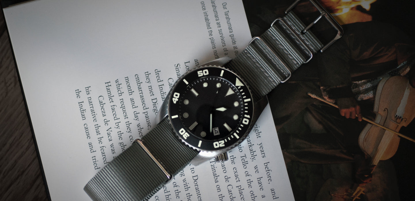 Enoksen - Blog Post - About The Deep Dive - Deep Dive Watch On Open Book Image