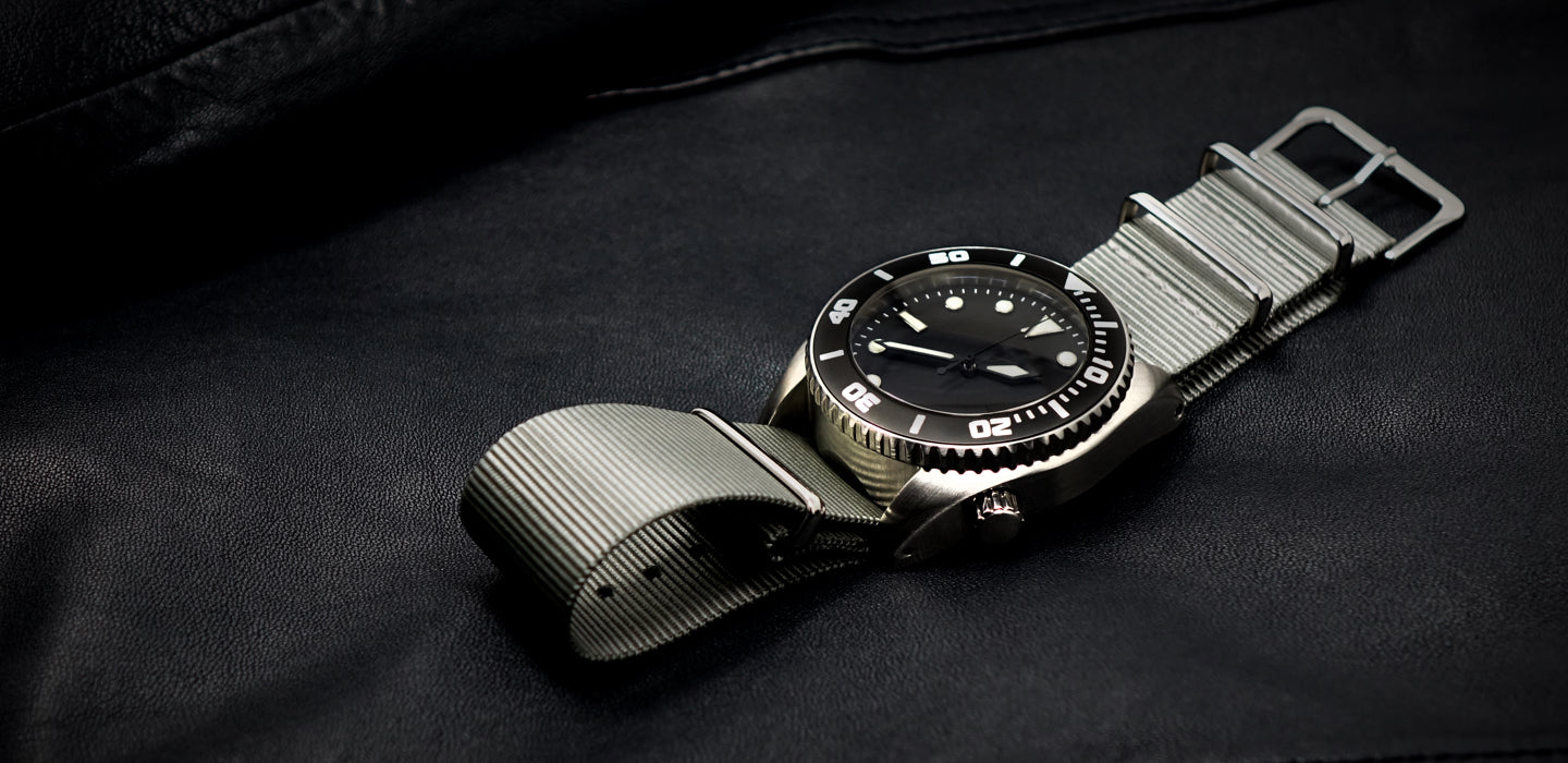 Enoksen - About Us - Deep Dive Watch On Wet Suit Image