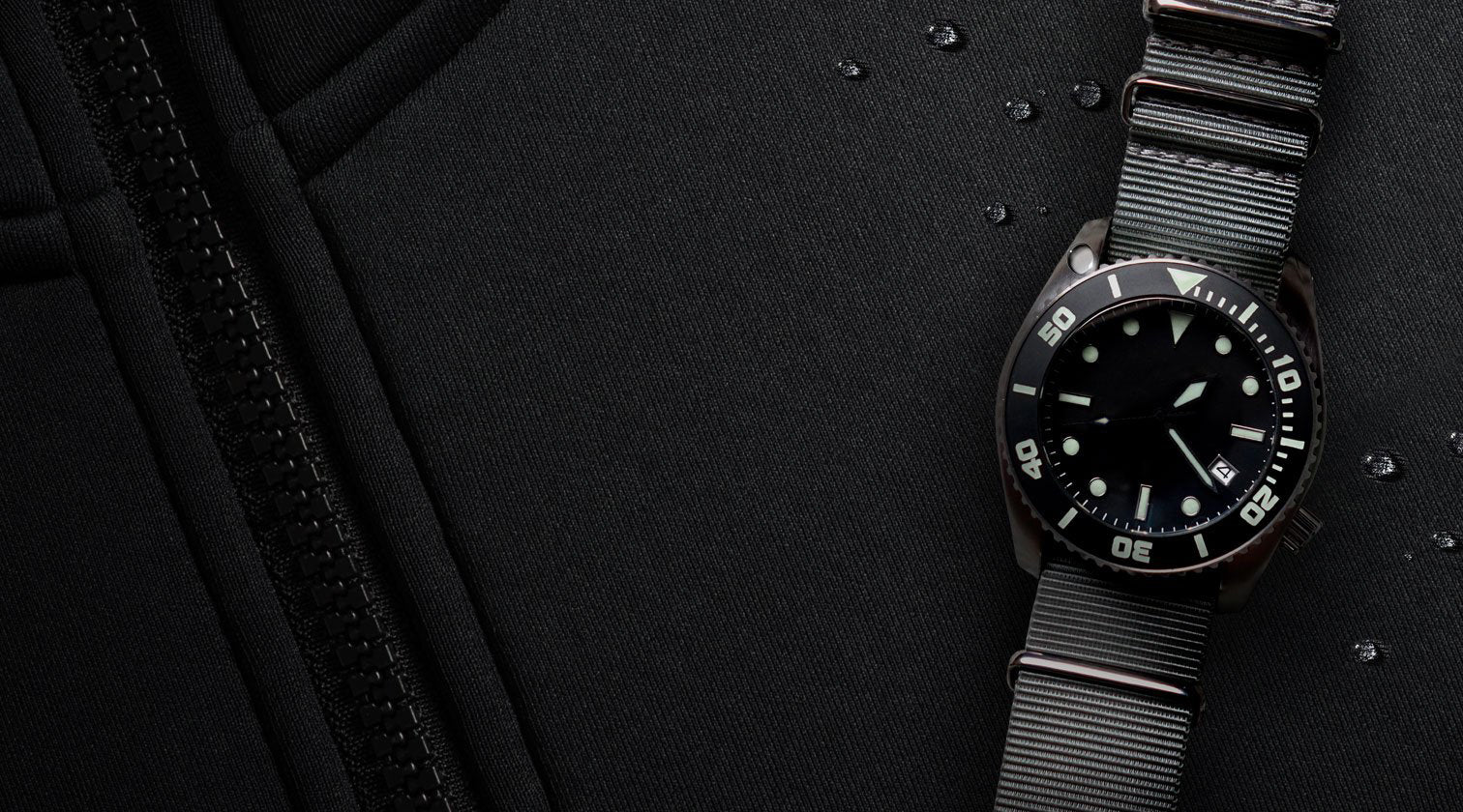 Enoksen - Blog Post - About The Deep Dive - Deep Dive Watch On Wet Suit Image