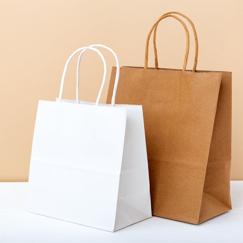 White Paper Carrier bags with twisted handles - GM Packaging (UK) Ltd