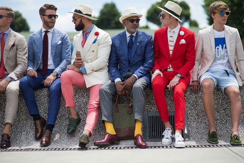 Group of men in loud colored suits at Pitti Uomo