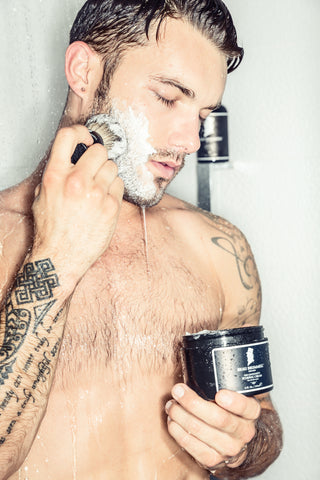 Man in Shower Lathering Face with Shaving Brush and Shaving Cream | Style Standard