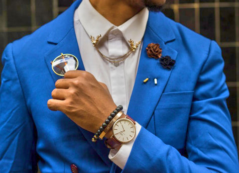 Man's chest in a blue suit and a variety of accessories