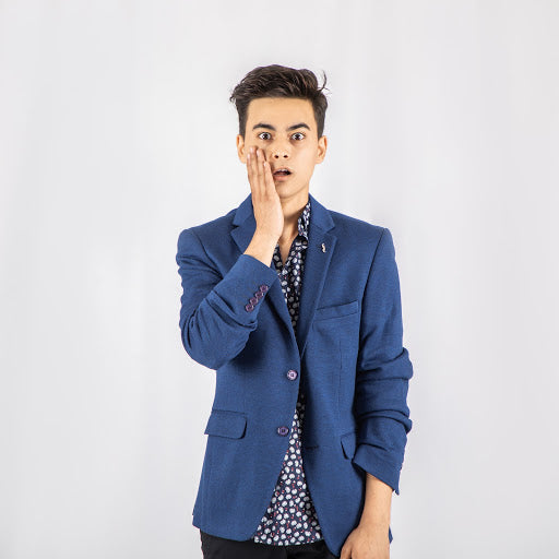 Man in blue blazer and patterned shirt with hand on face   Style Standard