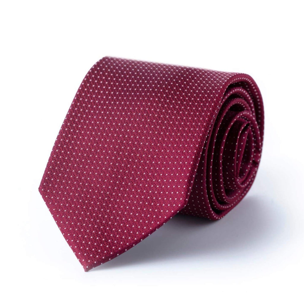 Maroon tie with white pindot pattern on a white background