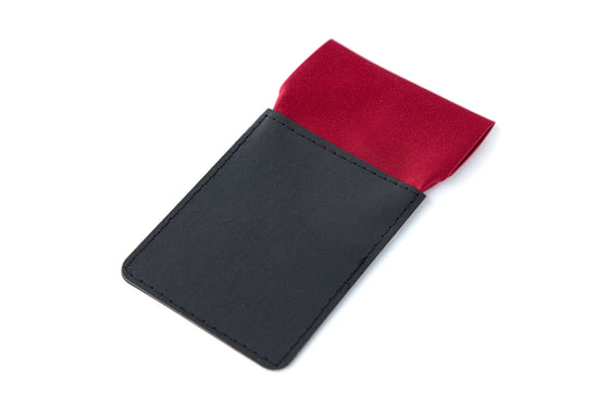 Red straight folded pocket square at top of black card