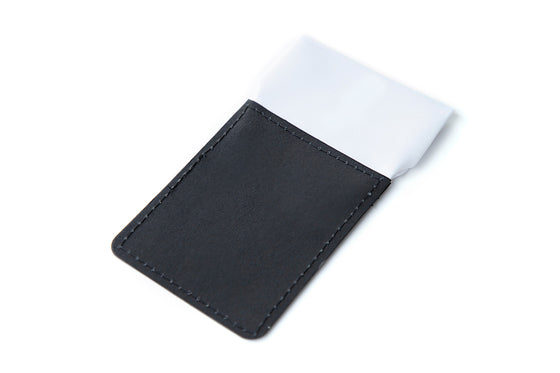 White straight folded pocket square at top of black card