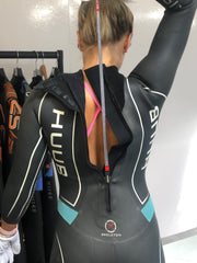 Pulling the zip up on Swimming Wetsuit