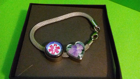 RiseShed Charm Bracelet with Medical Alert Charm in giftbox against green background