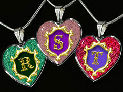 Letters R S T are shown against black background from the Alphabet Monogram Heart Pendant Range