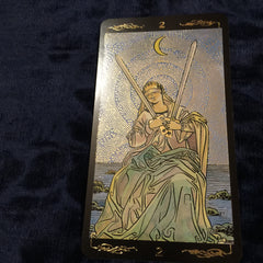 Two of Swords, Golden Universal Tarot.