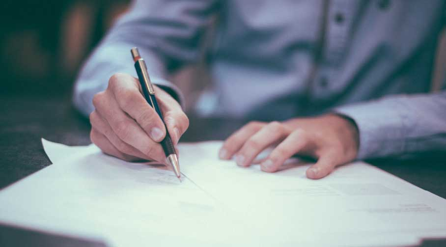 A person writing on paper