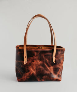 rugged standard leather tote with extraordinary pull up and color. Large tote with interior pocket. handmade leather goods
