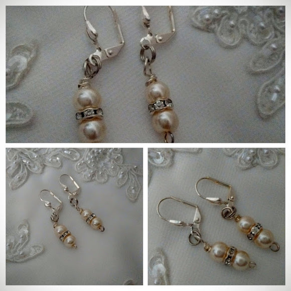 Two pearl straight drop earrings