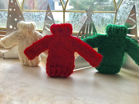 Three knit sweater ornaments