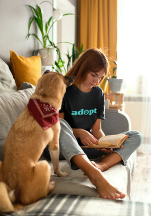 Photo of a woman-reading-next-to-her-dog - Wear_Pet - Black tshirt - Adopt Collection