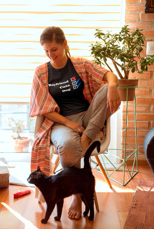 Photo-of-a-woman-wearing-sweatpants-and-a-black-t-shirt-sitting-near-her-black-cat--NO-Boyfriend-Cats 2 - Dog 1 -- Wear Pet